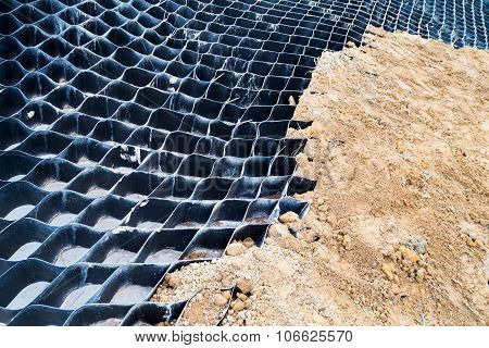 Close Up On Slope Erosion Control Grids On Steep Slope.