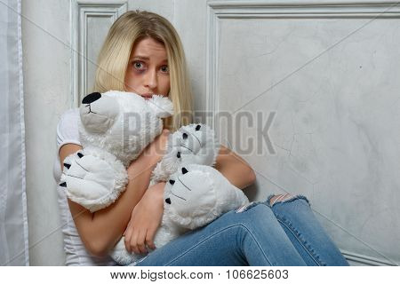 Depressed girl sitting on the floor