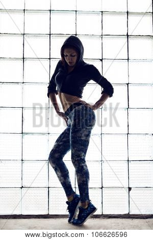 fitness woman, trained female body, lifestyle portrait, caucasian model
