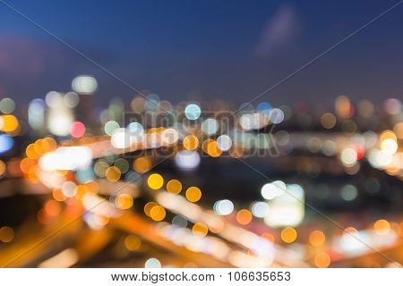 Aerial view city road intersection, blurred bokeh light background