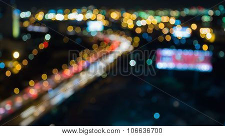 Abstract blurred bokeh city highway curved at night