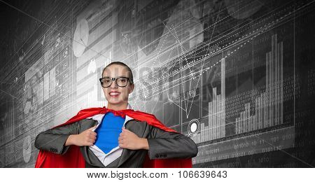 Young businesswoman in red cape acting like super hero
