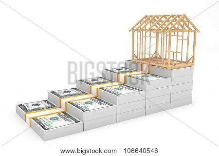 Real Estate Business Concept. House Frame Over Money Stack