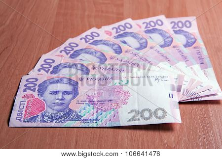 Ukrainian Banknotes For Two Hundred Hryvnias On A Wooden Table