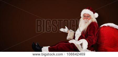 Santa sits leaned on his bag and has no clue against white background with vignette