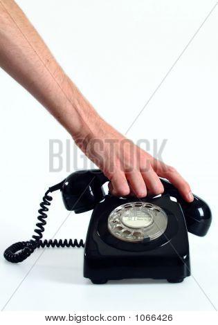 Hand Picking Up Phone
