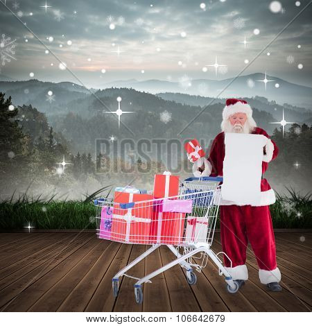 Santa delivering gifts from cart against mountain range beyond wooden floor