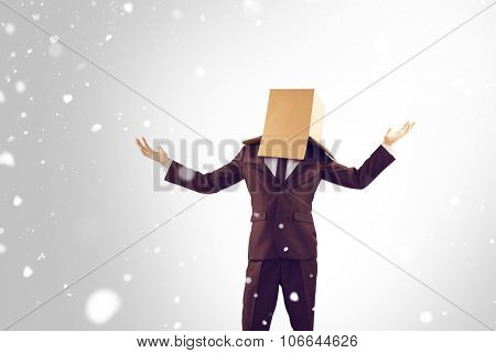 Anonymous businessman holding his hands out against snow