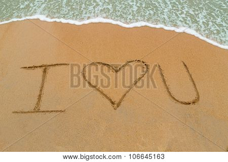 I Love You Drawn On Sandy Beach With Wave Approaching