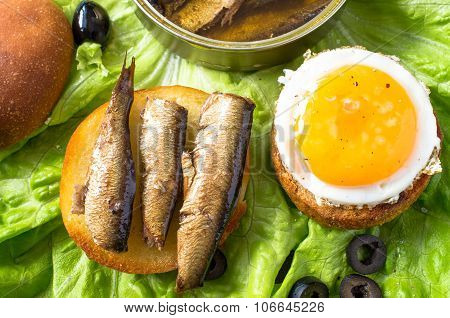 Burger With A Fried Egg And Sardines