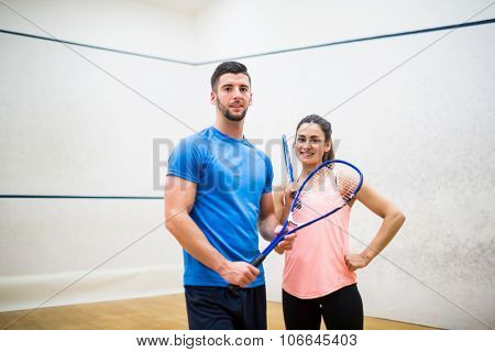 Happy couple after a squash game in the squash court