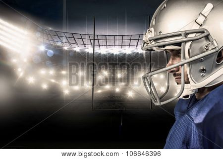 Close-up of American football player against american football arena