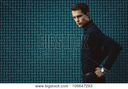 Man model in strict bdress on background with letters.