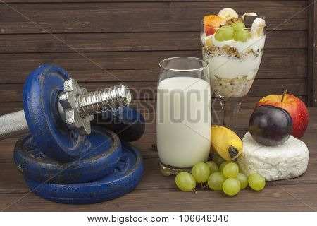 Diet for athletes build muscle mass. Protein snack. Dairy products and dumbbells