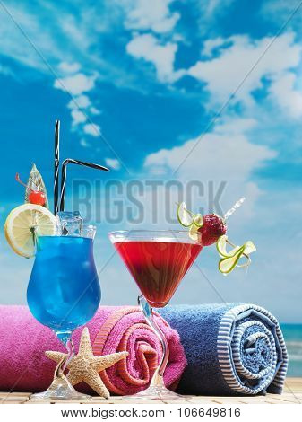 Blue lagoon and strawberry daiquiri cocktails on the beach