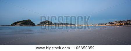 Beach of San Sebastian at dusk, panoramic view, Spain
