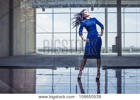Beautiful Woman In The Spacious Lobby With Flying Hair
