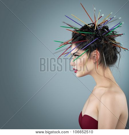 Fancy girl with needles in hair