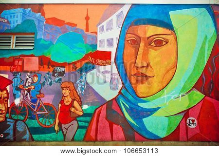 Graffiti With Face Of Woman In Hijab Living In Area Of Immigrants