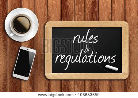 Coffee, Phone  And Chalkboard With Rules And Regulations