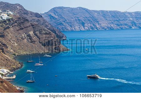 Santorini Bay With Many Yacht In Greece