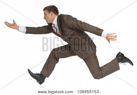 Businessman running fast with empty hand on white