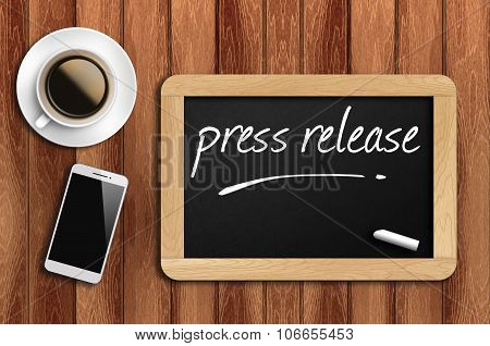 Coffee, Phone  And Chalkboard With Word Press Release
