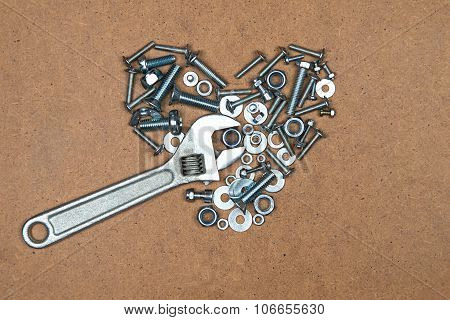 Heart with wrench from bolts and nuts