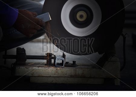 ?utting metal with grinder, Sparks while grinding iron