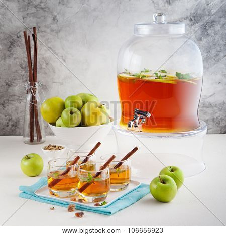 Apple, white wine punch, tea, mulled cider in beverage dispenser