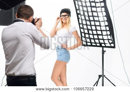 Female model poses professionally during photoshoot.