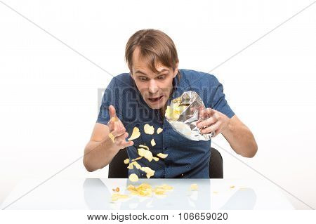 man scattered potato chips on the table