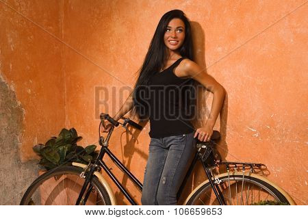 Beautiful Girl With A Retro Bicycle On The Street