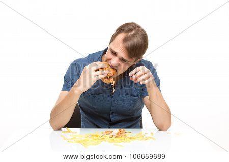 man is not careful eating tasteless burger.