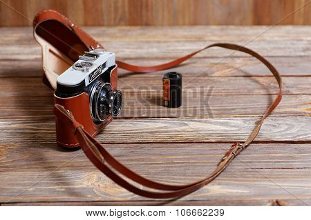Old Vintage Retro Photo Camera Smena-8 On Wooden Background