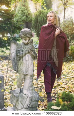 Woman Next To A Grave With An Angel