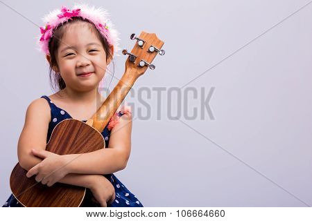Child With Ukulele / Child With Ukulele Background