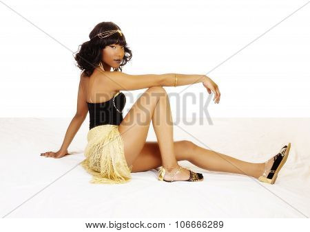Attractive African American Woman Sitting On Floor