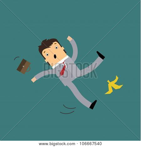 Businessman slipping on a banana