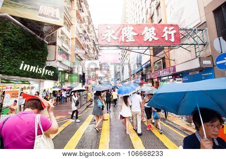 Many People In Mongkok Street In Rainy Day.