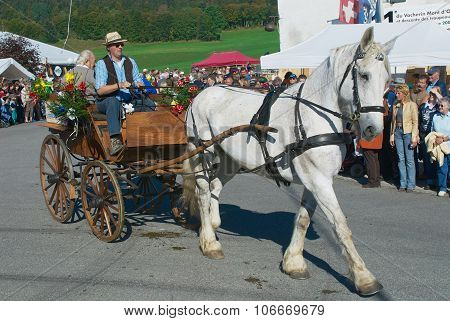 People ride traditional horse carriage at the annual Cheese Festival in Affoltern Im Emmental.