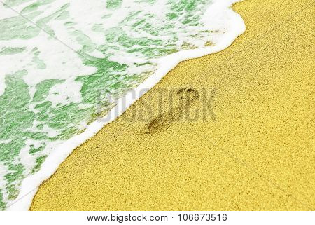 Human Trace On Sandy Beach Near Azure Sea Surf.