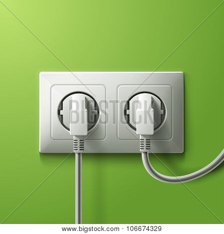 Realistic electric white double socket and 2 plugs on green wall background