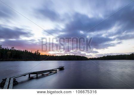 Foot-bridge in sunset