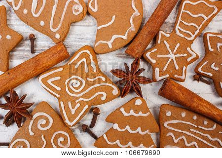 Fresh Baked Decorated Gingerbread With Spices On Old Wooden Background, Christmas Time