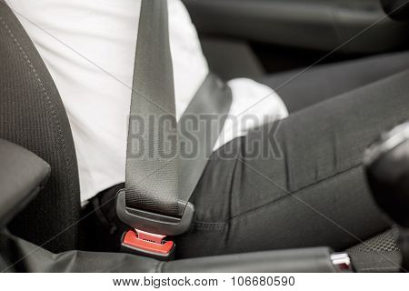 Buckled up person sitting in the car