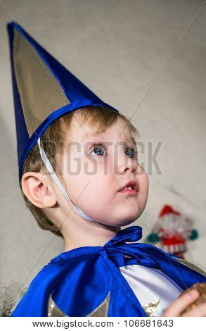 Astonished Baby In New Year Costumes