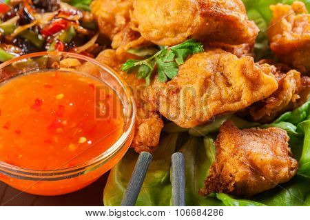 Chicken Pieces In Batter With Sweet And Sour Sauce