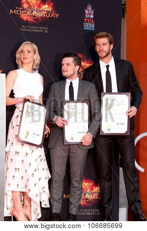 LOS ANGELES - OCT 31:  Jennifer Lawrence, Josh Hutcherson, Liam Hemsworth at the Hunger Games Handprint and Footprint Ceremony at the TCL Chinese Theater on October 31, 2015 in Los Angeles, CA