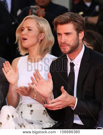 LOS ANGELES - OCT 31:  Jennifer Lawrence, Liam Hemsworth, guests at the Hunger Games Handprint and Footprint Ceremony at the TCL Chinese Theater on October 31, 2015 in Los Angeles, CA